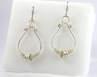 Silver baroque style earring.