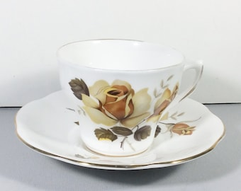 Delphine Fine Bone China Cup and Saucer. blue yellow flowers