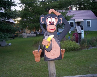 primate  monkey mailbox holding a banana and scratching his head custom mail box