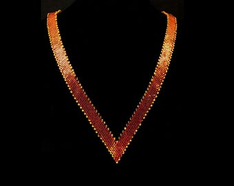 Necklace in Orange and Gold Tone Beads