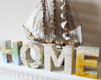 Find your way HOME - Four 3d letters made from maps