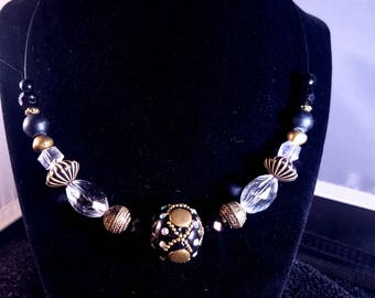 Modern, statement black and gold multi bead necklace
