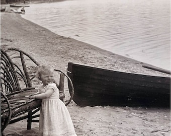 Baby Girl at Bent Twig Chair w Boat in Water Vintage Photo Print