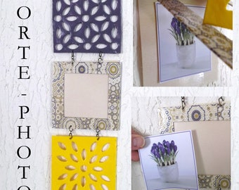 Photo frame made of 3 square purple arabesques and yellow, Hung one below the other