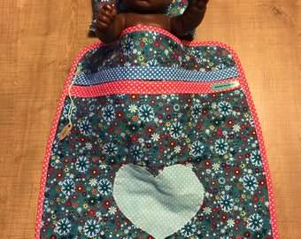 Blue floral doll with heart blanket