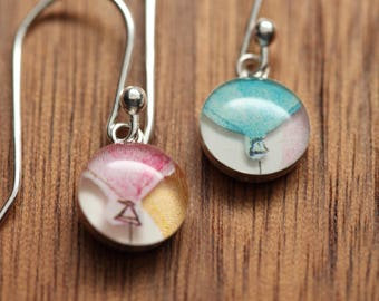 Tiny balloon earrings made from recycled Starbucks gift cards. sterling silver and resin.