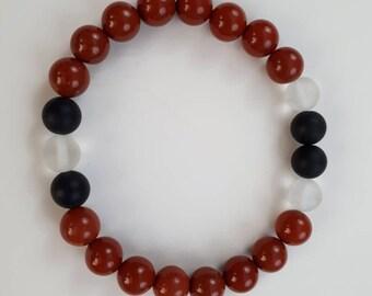 High quality vegan, ethical, handmade gemstone bracelet. Beads; red jasper, matte black onyx and frosted quartz.