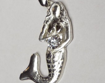 Silver mermaid holding CZ stone