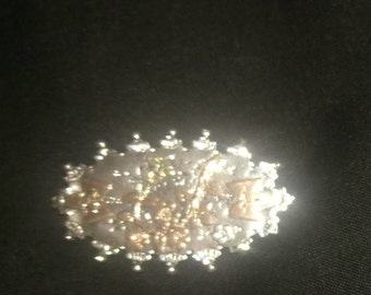 beautiful silver brooch with rose gold flowers