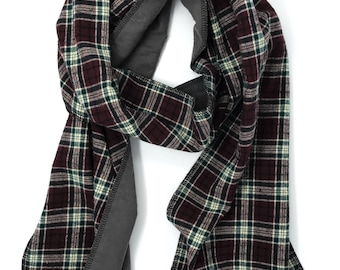 Maroon, green, and gray plaid flannel scarf.