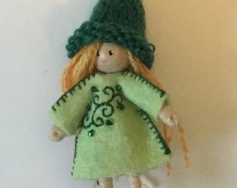 small girl elf bendy doll dressed in green