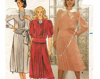 "A Short/Long Sleeve, Jewel Neck, Tucked, Peplum Band Top & A-Line 2 Lengths Skirt Pattern for Women: Size 10, Bust 32-1/2"" • Butterick 6839"