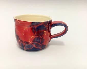 Red and blue giraffe pattern mug