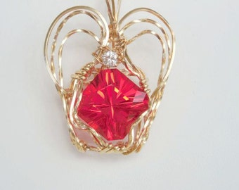 Fantasy Machine cut Red Stone Wrapped in 14kt Gold Filled with CZ accent