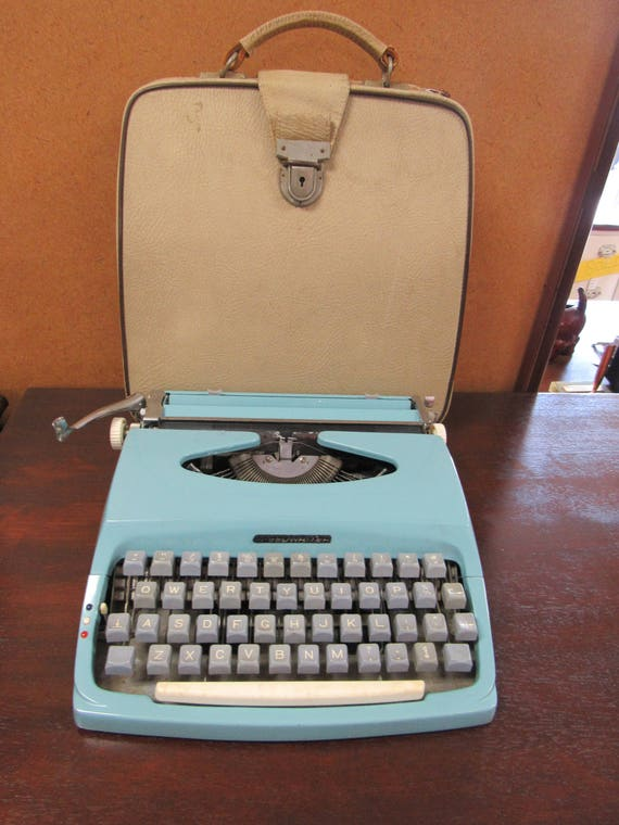 Blue portable typewriter - by Chevron, works great