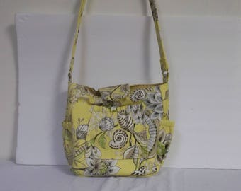 Custom made yellow light green tan and white shoulder purse with flowers and snails 5 pockets one on the inside with a zipper pockets