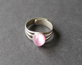Silver tone costume ring with pink faux moonstone UK size K adjustable