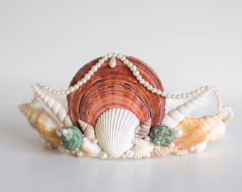 Adult mermaid crown featuring a large central saucer scallop shell with pearl beading, conch and cockle shells.