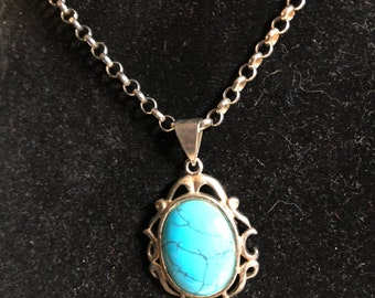 Oval Silver & Turquoise ornate pendant on a silver necklace