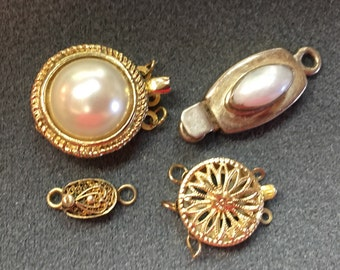 Four Vintage Necklace Clasps-Three Silver and One Gold-filled.  Free shipping