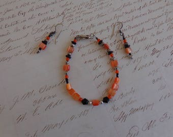 Bracelet Set  Beaded bracelet and pierced earrings in peachy orange and black with silvertone beads