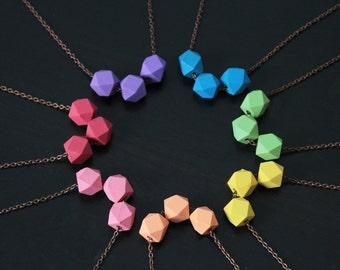 collier perle geometrique