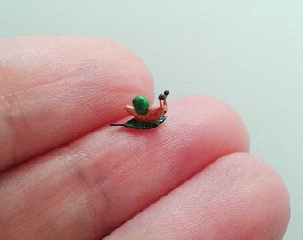 Tiny snail on the leaf figurine.