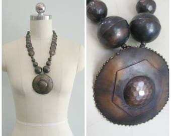 Brassy Hammered Discus Bobble Necklace.
