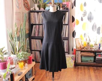 vintage 1960s mod scooter dress . black drop waist dress with pleated skirt . womens xs small sleeveless dress