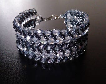 Double flat spiral black and crystal bracelet