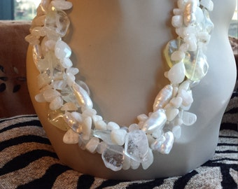 Four strand beaded necklace made with moonstone, freshwater pearls, and opulite