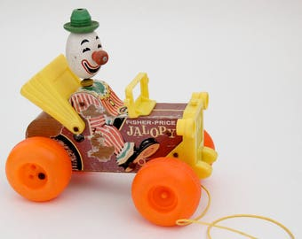 Vintage Fisher Price wooden pull-along 'JALOPY' car toy with moving clown figure, 1965