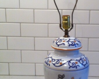 "Ceramic or Stoneware Lamp, White with Blue and Rust Motif, Signed ""Marian Abbey"""