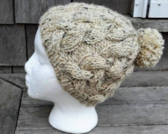 Cabled pompom wool hand-knit hat