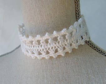 Necklace lace crochet art and fork.