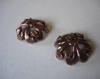 Set of 2 caps in copper metal