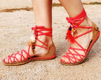 Greek espadrilles sandals with feathers and ornaments. Colour coral red. Alpargatas made in Spain