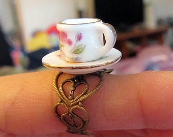 Alice in Wonderland Porcelain Hand Painted Tea cup saucer ring