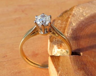 1/2 Carat diamond solitaire 18k yellow gold ring.
