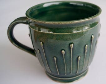 Hand-turned ceramic cup with ornament.