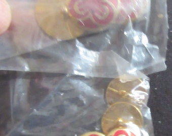 red or gold flower buttons
