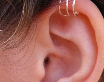 """Ear cuff... """"Simple lines"""" silver hand wire wrapped ear cuff."""