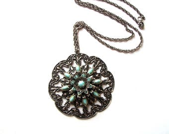 large vintage silver and turquoise medallion necklace with filigree background