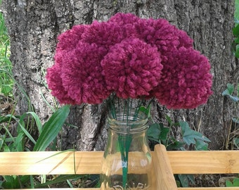 12 Cranberry/ burgundy yarn pom pom flowers. Pom pom bouquet centerpieces. Wedding/ baby shower decorations. Home decor.