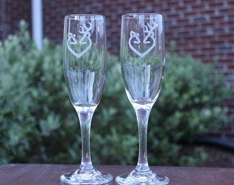 Set of 2 Champagne flutes with browning buck and doe heart