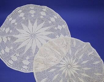 Vintage crochet doilies. Set of two circular doilies, very pale peachy colour.