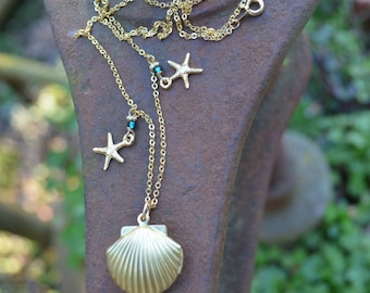 Golden Seashell Locket Necklace with tiny starfish charms and sea blue beads