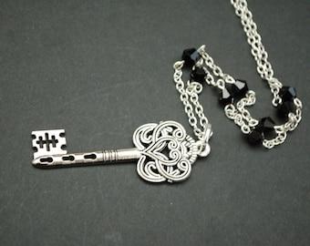 Silver tone large ornate key beaded necklace