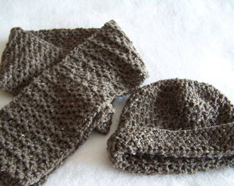 Grayish brown colored infinity scarf with matching hat.
