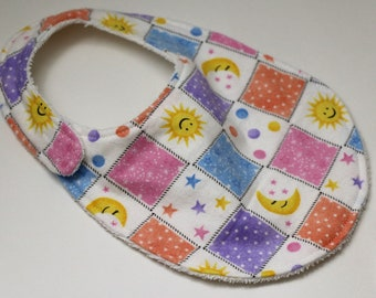 Sun, Moon, & Stars Squares flannel reversible baby bib with White terry cloth